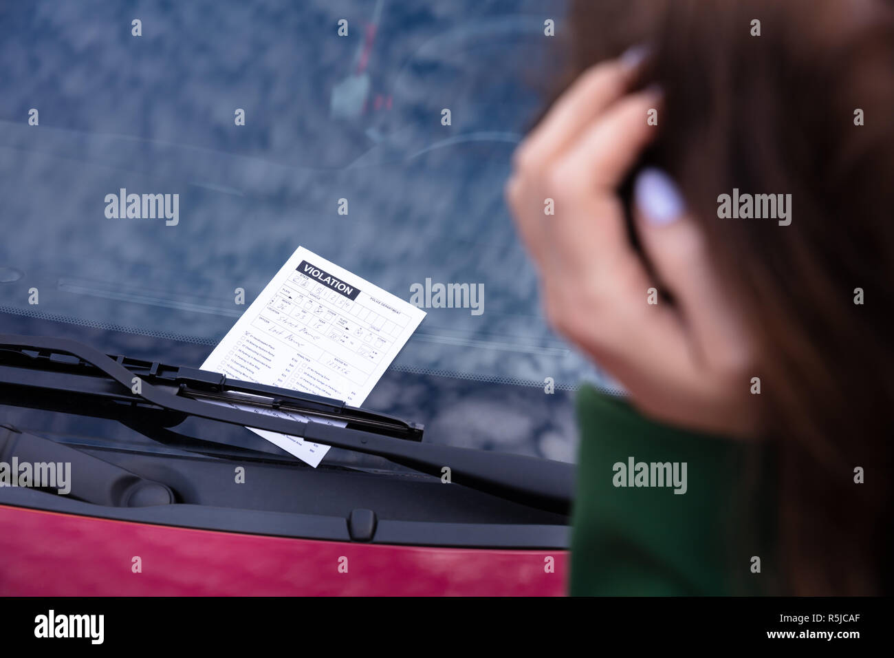 Close-up Of A Woman Near Car With Ticket Fine For Parking Violation - Stock Image