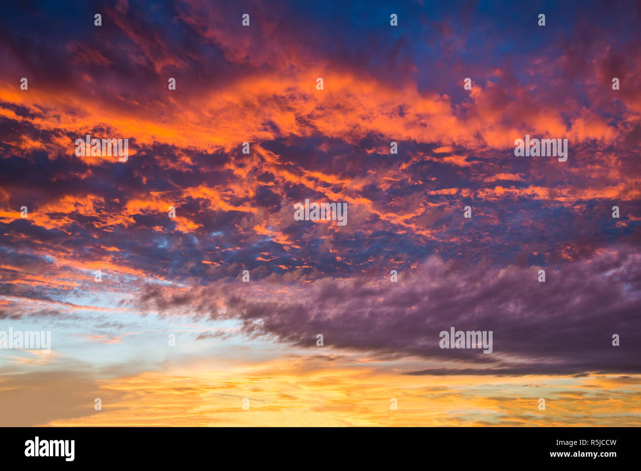 Sunrise paints a very dramatic and colorful morning sky. Stock Photo