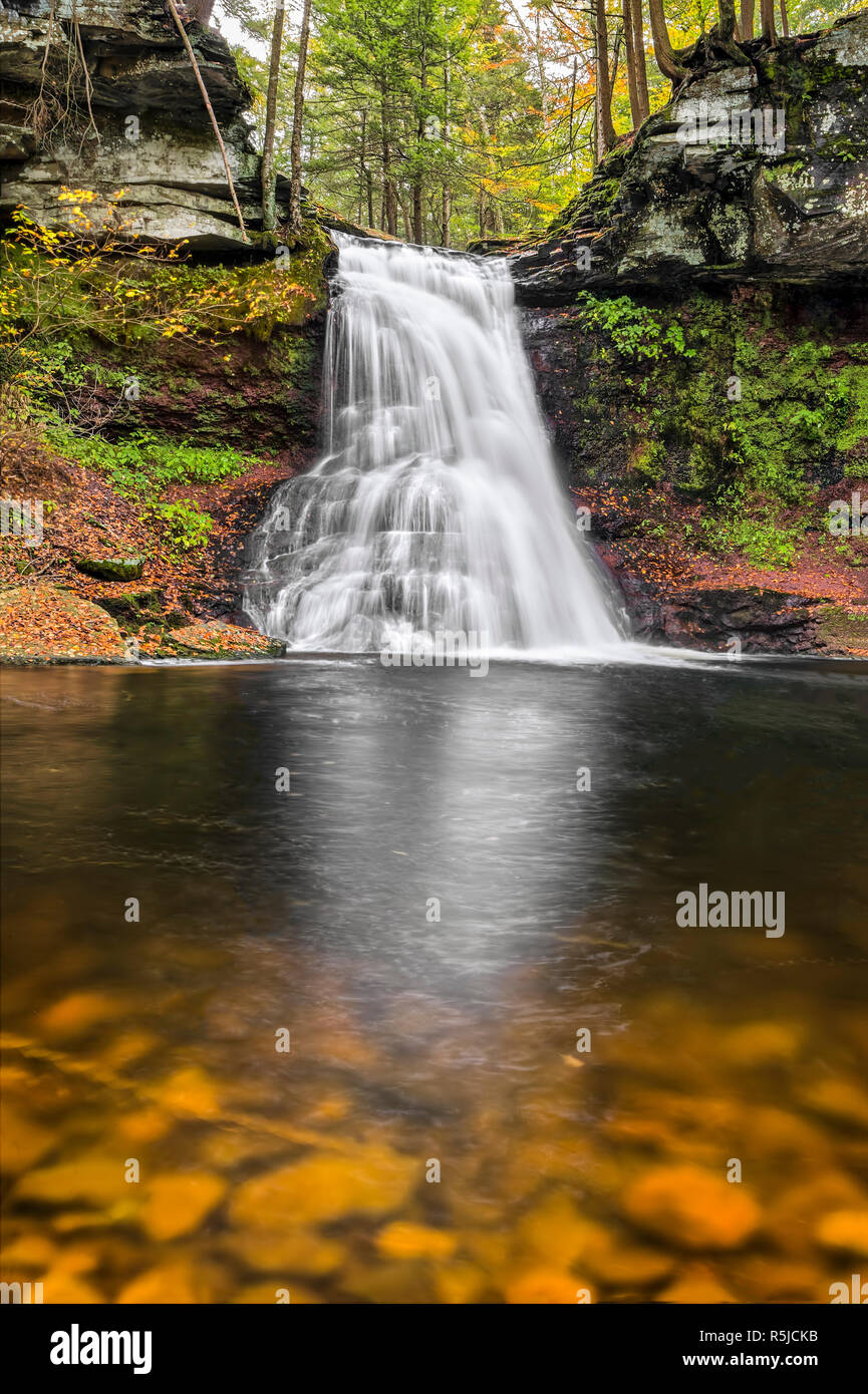 Sullivan Falls, a beautiful Pennsylvania waterfall, splashes down a cliff in an autumn landscape. Stock Photo