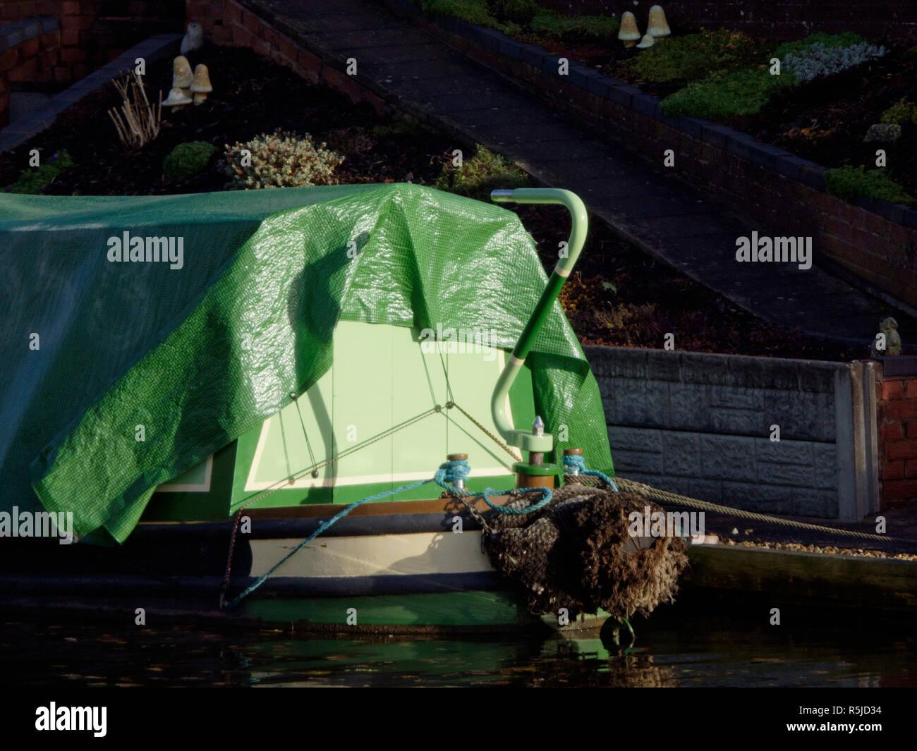 Green Tarpaulin Sheeting Covering a Narrowboat, UK - Stock Image