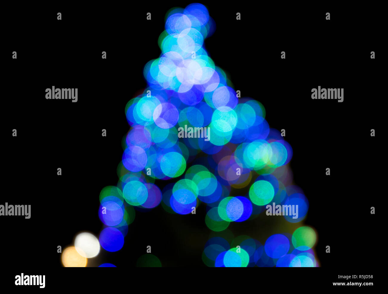 Christmas tree multicoloured lights, blurred to give an abstract effect. - Stock Image