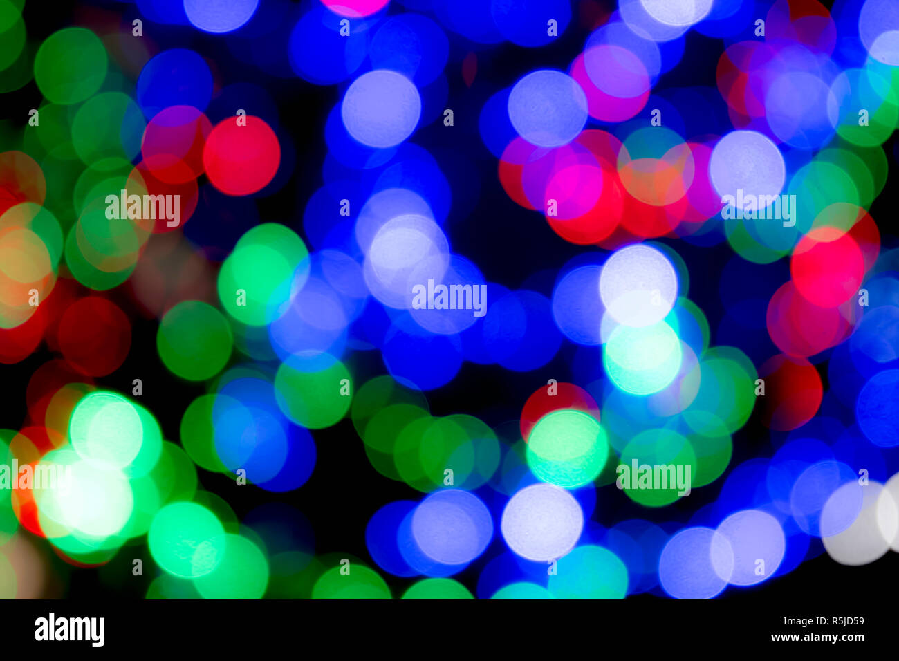 Christmas and festive multicoloured lights, blurred to give an abstract effect and colourful Christmas background. Stock Photo