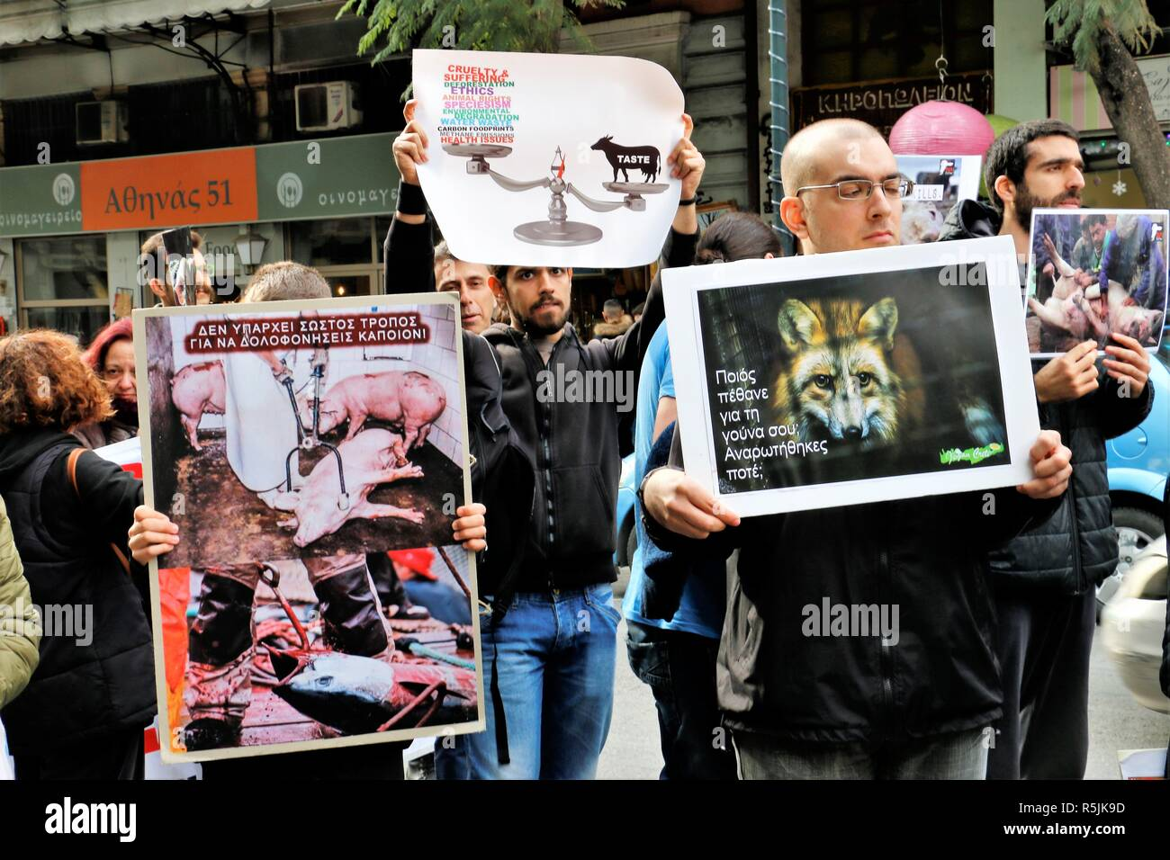 Athens, Greece. 1st Dec, 2018. Protesters are seen holding placards during the protest.Animal right activists demonstrate in Athens against animals' abuse, violence, mistreatment towards animals and promoting a vegan way of life. Credit: Helen Paroglou/SOPA Images/ZUMA Wire/Alamy Live News - Stock Image