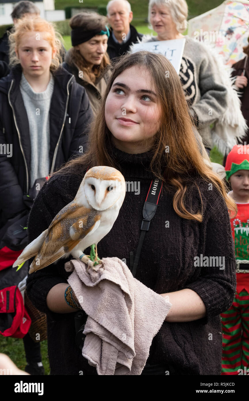 Hereford, UK. 1st December, 2018. Lily Dugdale, zoologist, with her barn owl at a demonstration by the newly formed local branch of the Extinction Rebellion movement (climate change activists) in this old cathedral city . Credit: Alex Ramsay/Alamy Live News - Stock Image