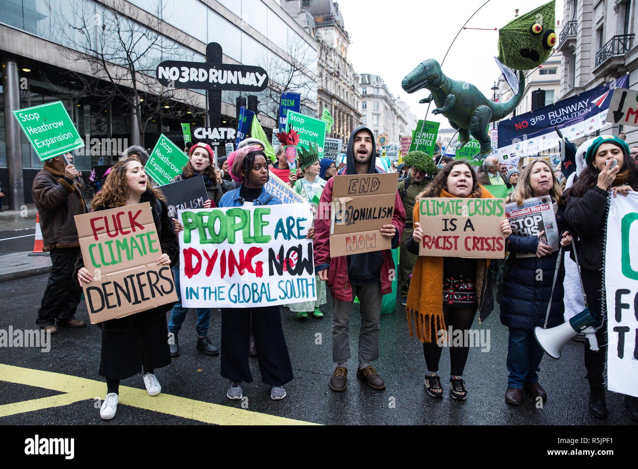 London, UK. 1st December, 2018. Environmental campaigners pass in front of the Brazilian embassy on the Together for Climate Justice demonstration in protest against Government policies in relation to climate change, including Heathrow expansion and fracking. Following a rally outside the Polish embassy, chosen to highlight the UN's Katowice Climate Change Conference which begins tomorrow, protesters marched to Downing Street. Credit: Mark Kerrison/Alamy Live News Stock Photo