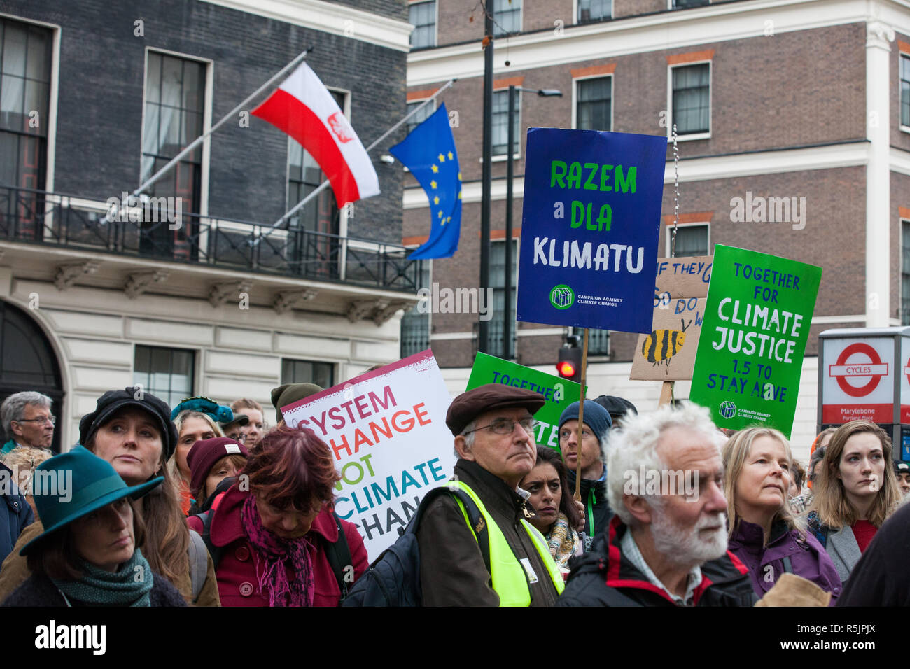 London, UK. 1st December, 2018. A placard bearing a message in Polish is held by environmental campaigners outside the Polish embassy during a Together for Climate Justice demonstration in protest against Government policies in relation to climate change, including Heathrow expansion and fracking. Following a rally outside the Polish embassy, chosen to highlight the UN's Katowice Climate Change Conference which begins tomorrow, protesters marched to Downing Street. Credit: Mark Kerrison/Alamy Live News Stock Photo