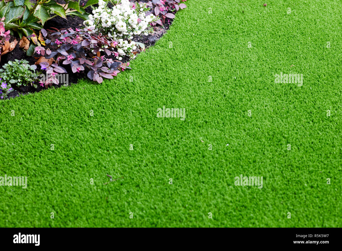 maintenance free artificial turf  lawn a modern synthetic grass carpet - Stock Image