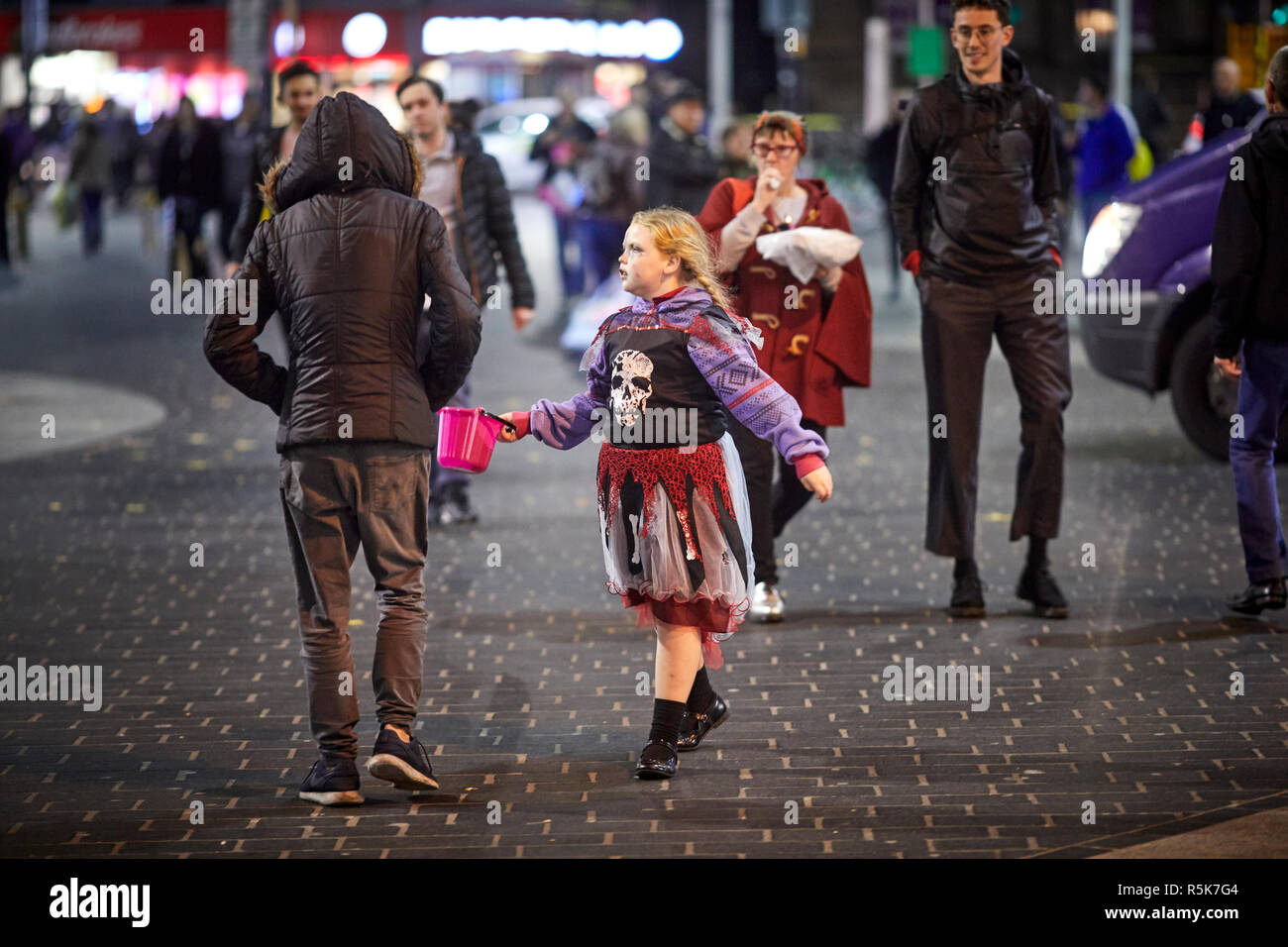 Liverpool city centre irish traveler children begging for money dressed as Halloween costumes - Stock Image
