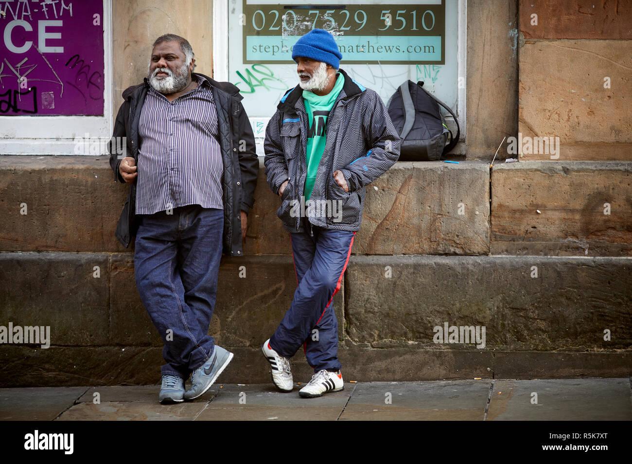 Liverpool city centre  Bold Street, asian men resting - Stock Image