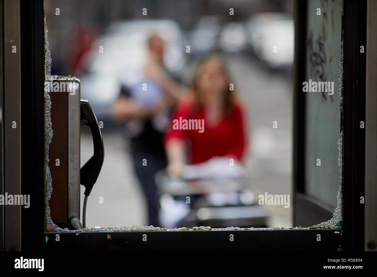 Liverpool city centre telephone kiosk box glass window smashed by vandals - Stock Image