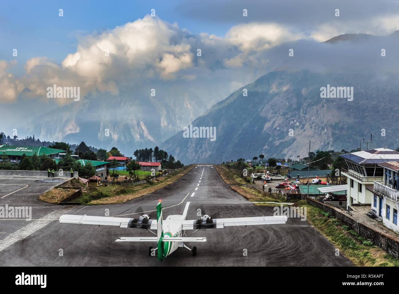 Lukla, Nepal - Nov 5, 2018: Plane is taking off from Hillary - Tenzing airport 500m runway in Lukla, Nepal. - Stock Image