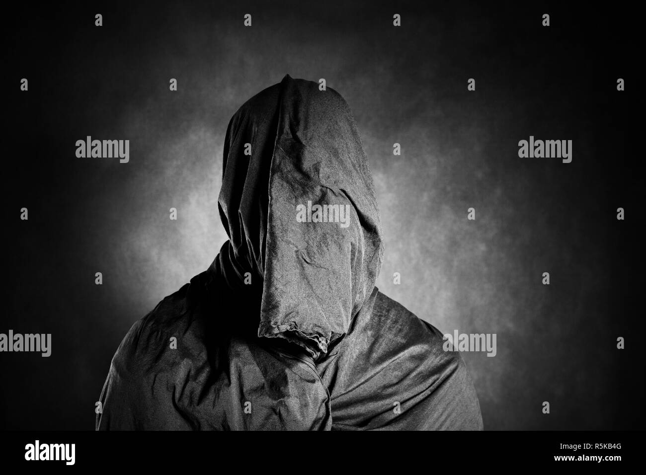Ghostly figure in the dark - Stock Image