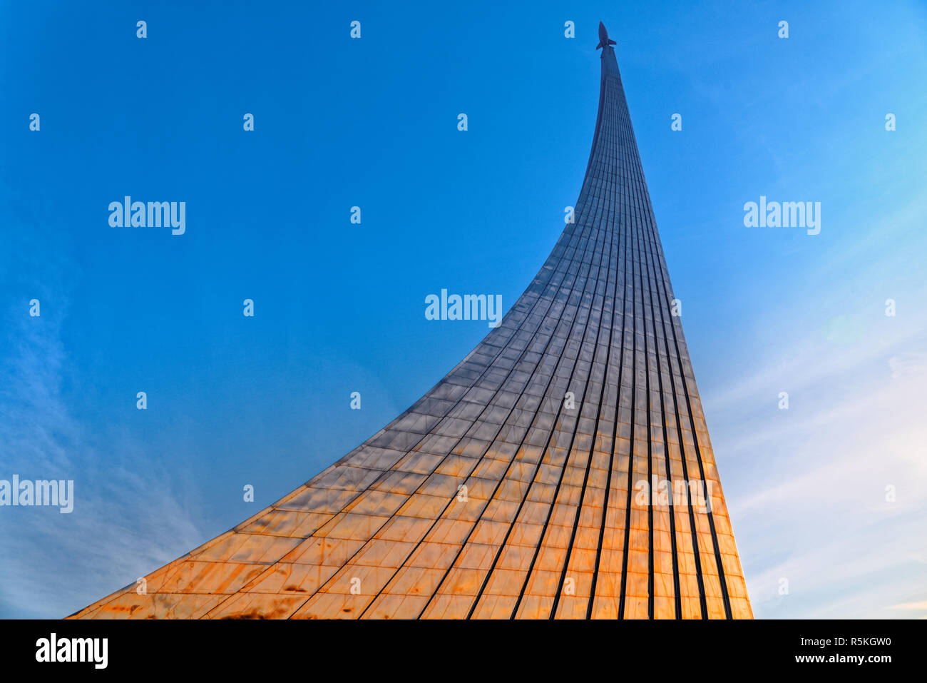 Monument to the Conquerors of Space at the Exhibition of Economic Achievements in Moscow on the background of an autumn, overcast sky with clouds. - Stock Image