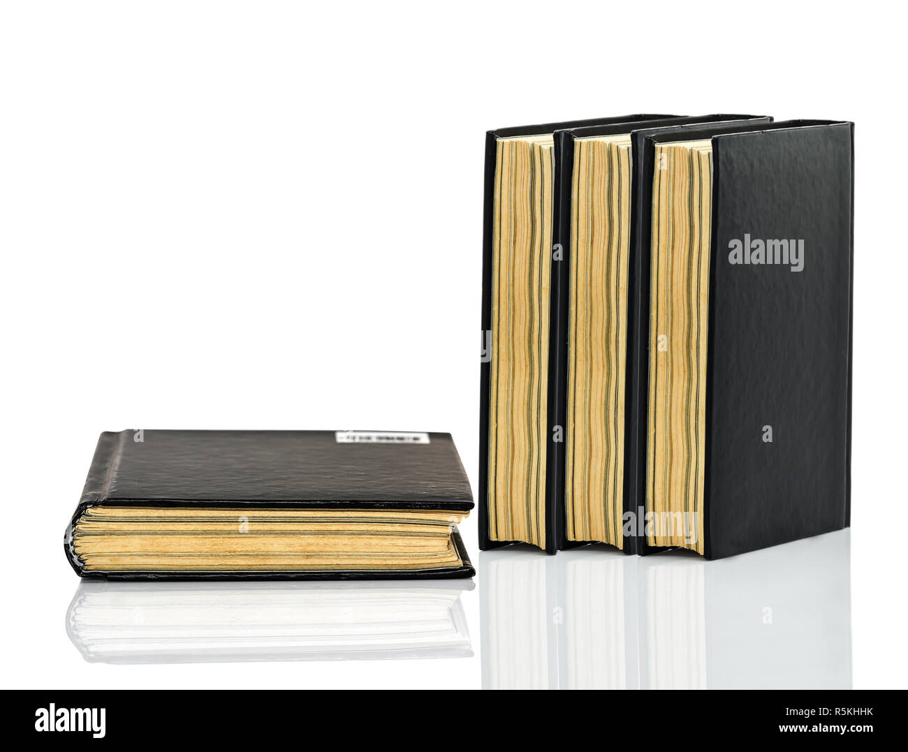 Black book is laying with shadow on white background - Stock Image