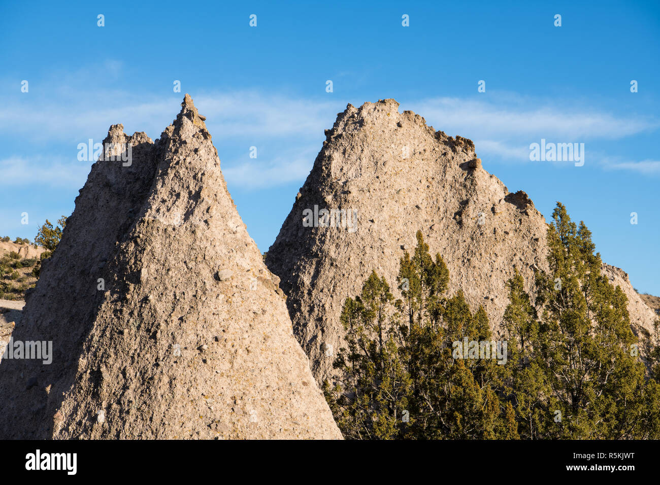 Sharp peaks of two highly textured rock formations at Kasha-Katuwe Tent Rocks National Monument, New Mexico - Stock Image
