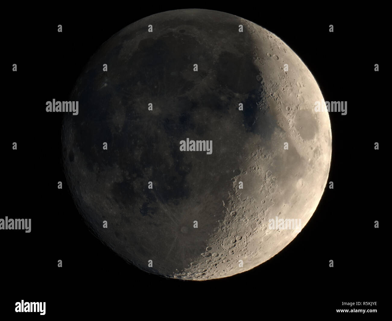 waxing crescent moon seen with telescope stock photo 227240034 alamy