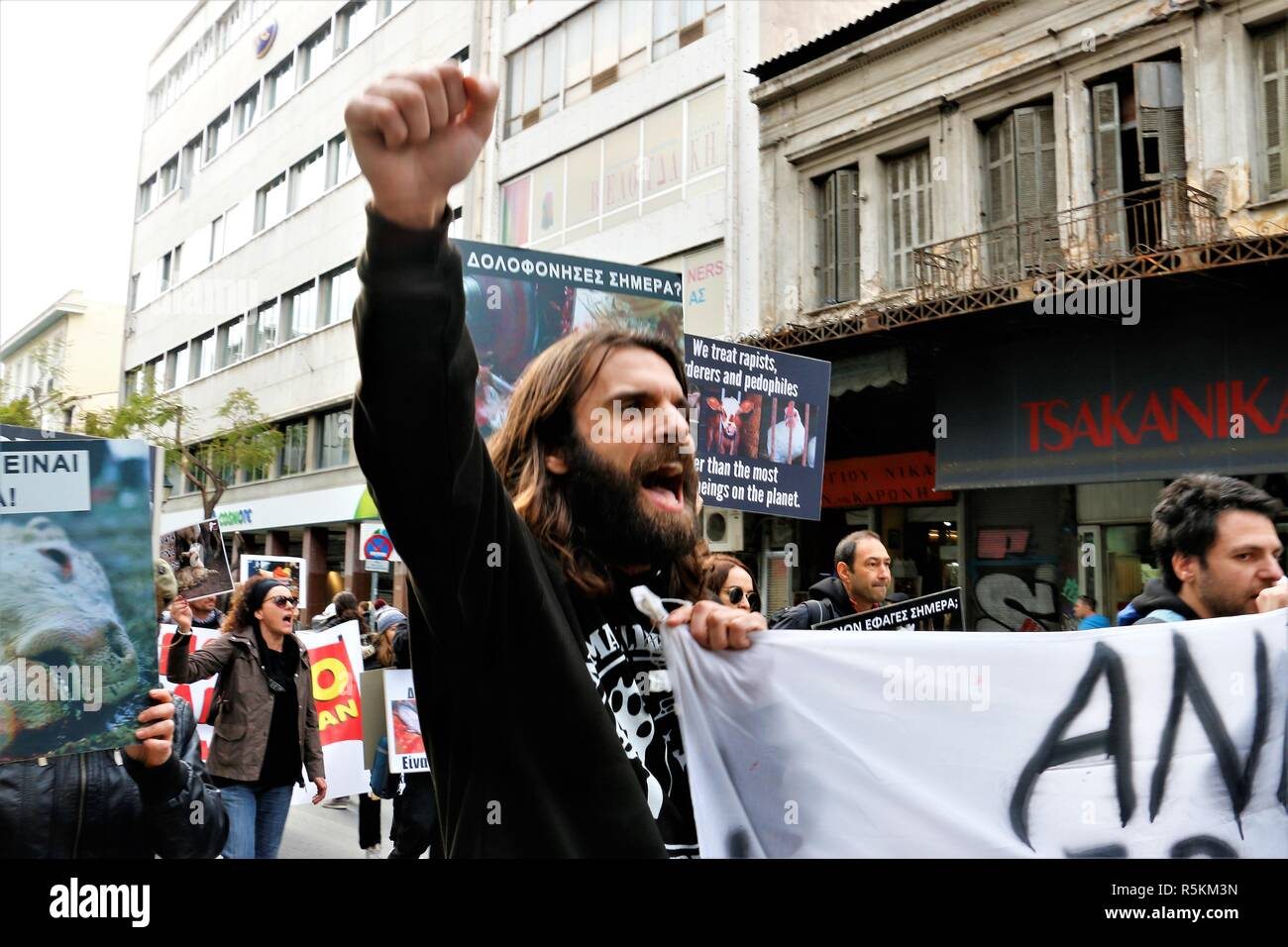A protester seen chanting slogans during the protest. Animal right activists demonstrate in Athens against animals' abuse, violence, mistreatment towards animals and promoting a vegan way of life. - Stock Image