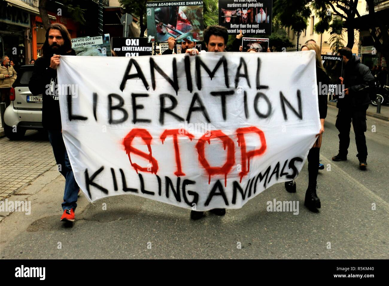 Protesters are seen holding a banner during the protest. Animal right activists demonstrate in Athens against animals' abuse, violence, mistreatment towards animals and promoting a vegan way of life. - Stock Image