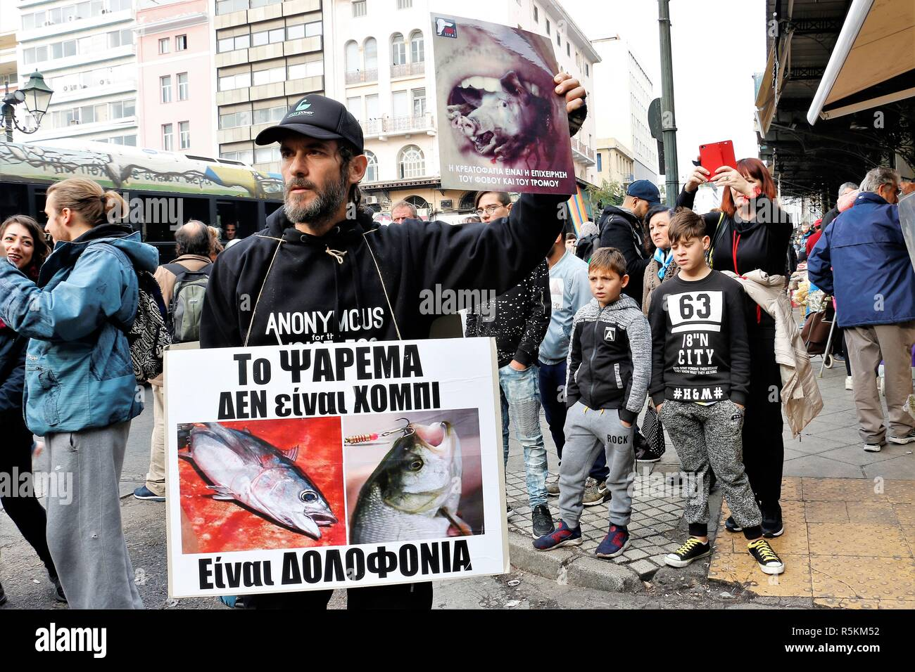A protester seen holding placards during the protest. Animal right activists demonstrate in Athens against animals' abuse, violence, mistreatment towards animals and promoting a vegan way of life. - Stock Image