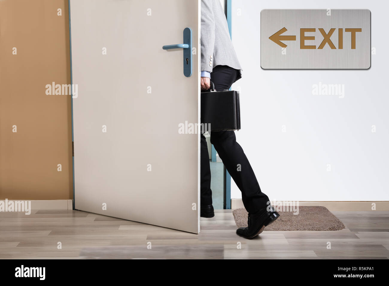 Businessperson Walking Out - Stock Image