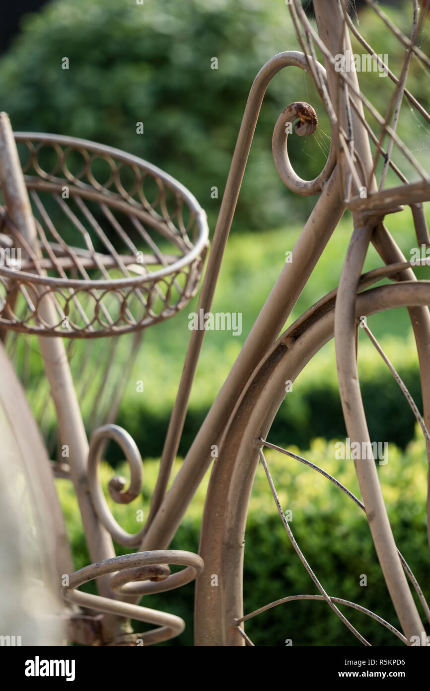 Bicycle rack as decoration for the garden Stock Photo
