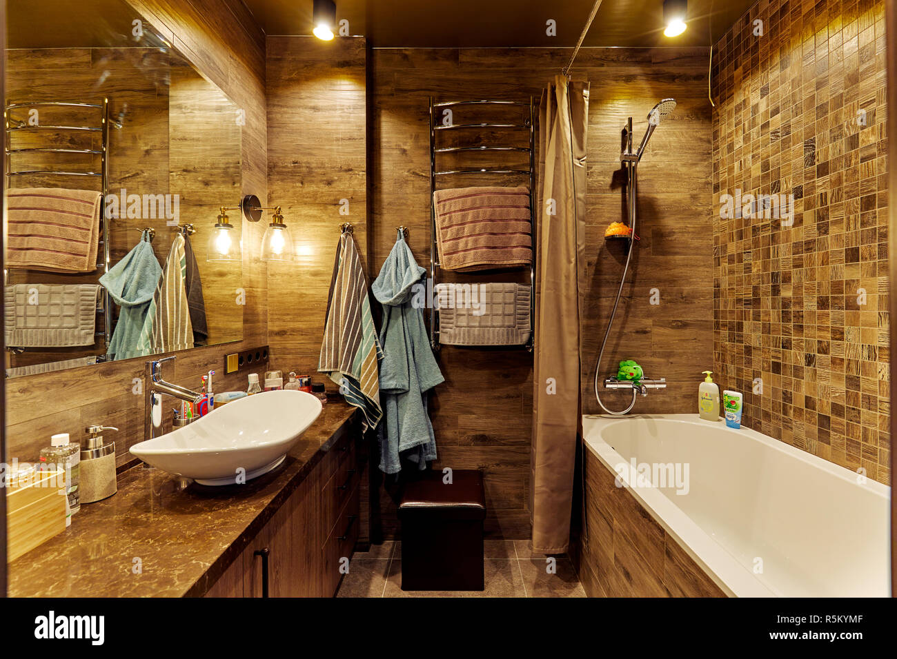 Eindhoven, The Netherlands - December 19, 2018: Interior of a contemporary bathroom with bathtub, in natural earth colors. - Stock Image
