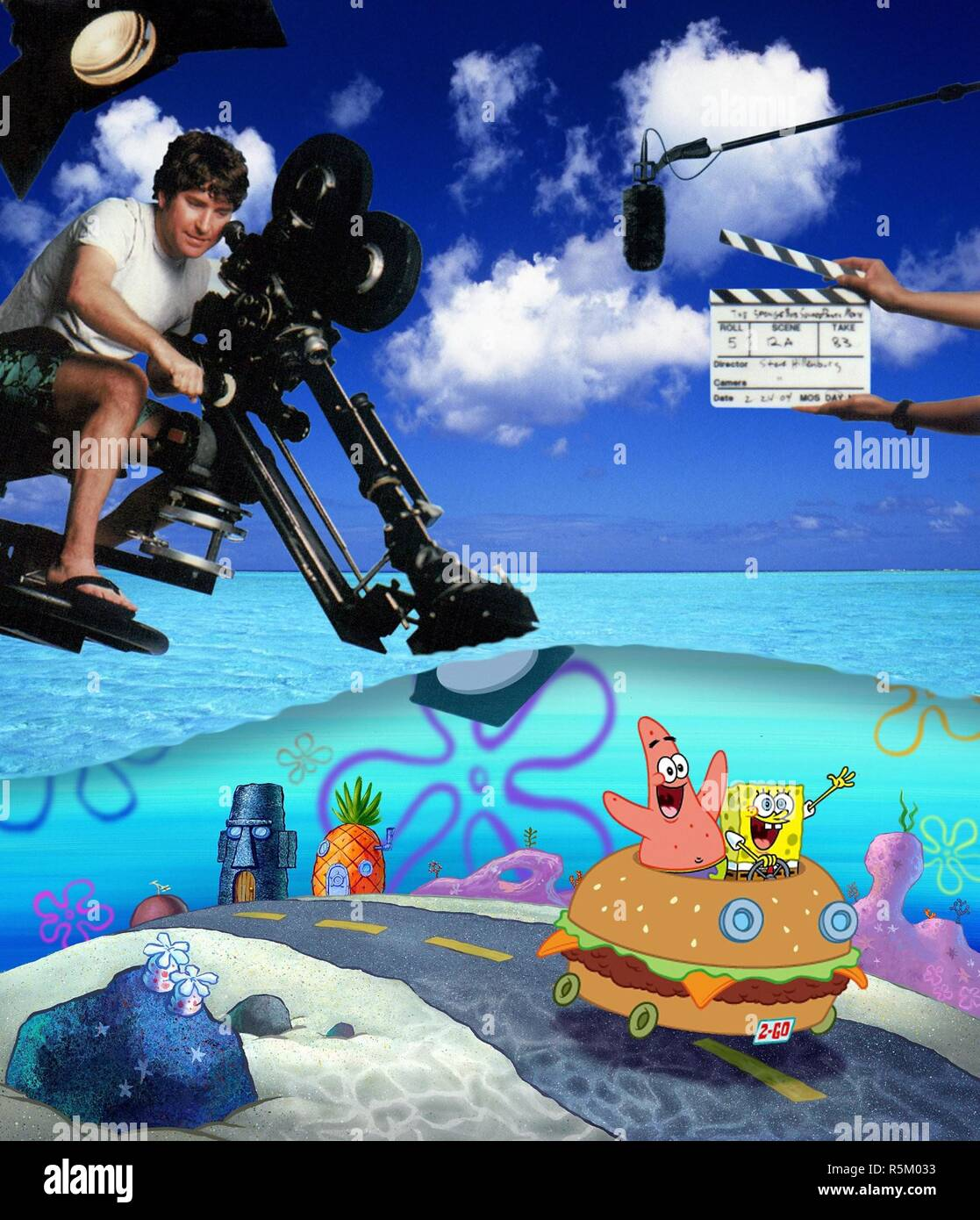 RELEASE DATE: November 19, 2004. MOVIE TITLE: Spongebob Squarepants the Movie. STUDIO: Paramount Pictures. PLOT: There's trouble brewing in Bikini Bottom. Someone has stolen King Neptune's crown, and it look like Mr. Krab, SpongeBob's boss, is the culprit. Though he's just been passed over for the promotion of his dreams, SpongeBob stands by his boss, and along with his best pal Patrick, sets out on a treacherous mission to Shell City to reclaim the crown and save Mr. Krab's life. PICTURED: STEPHEN HILLENBURG on the set. Original film title: THE SPONGEBOB SQUAREPANTS MOVIE. English title: THE  - Stock Image