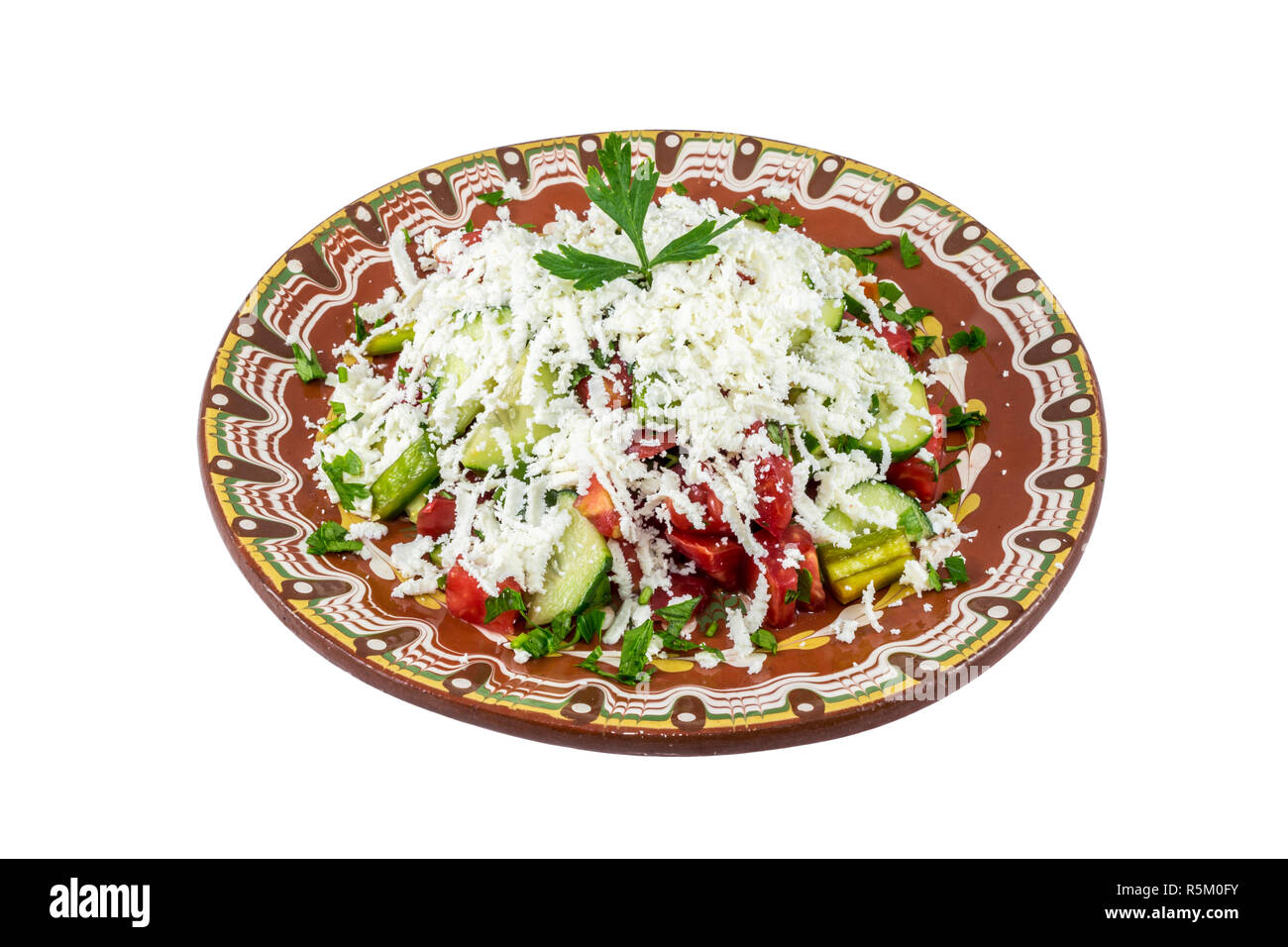 Traditional bulgarian Shopska salad isolated on white bakcground. Made by classic recepie. - Stock Image