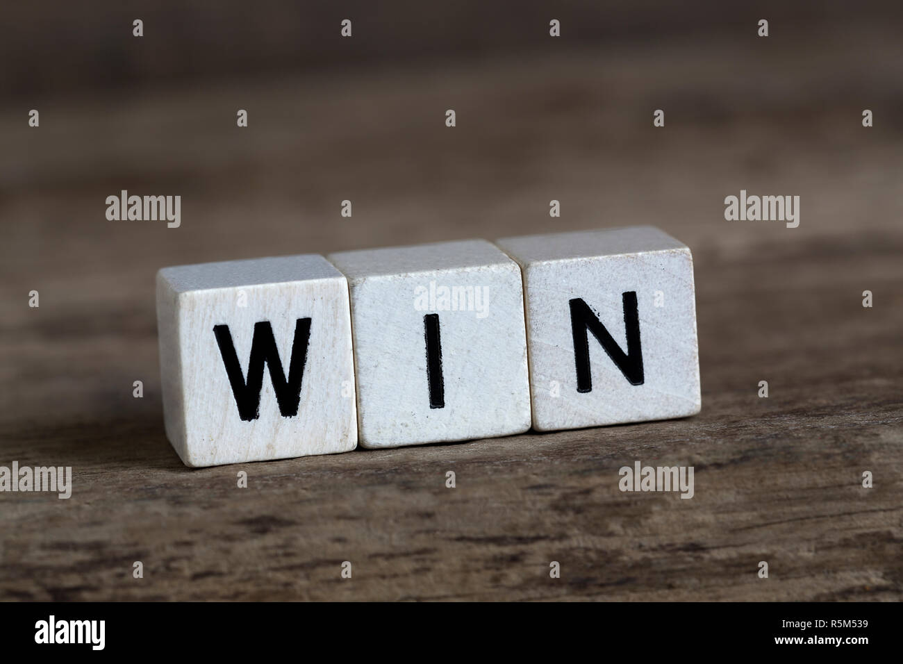 Win, written in cubes - Stock Image