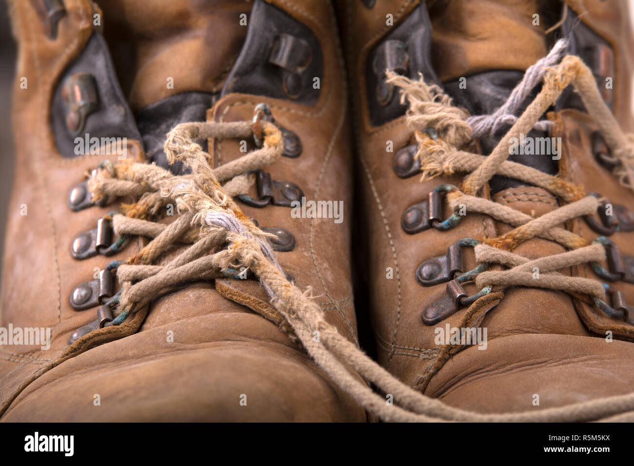 old hiking boots with broken laces - Stock Image