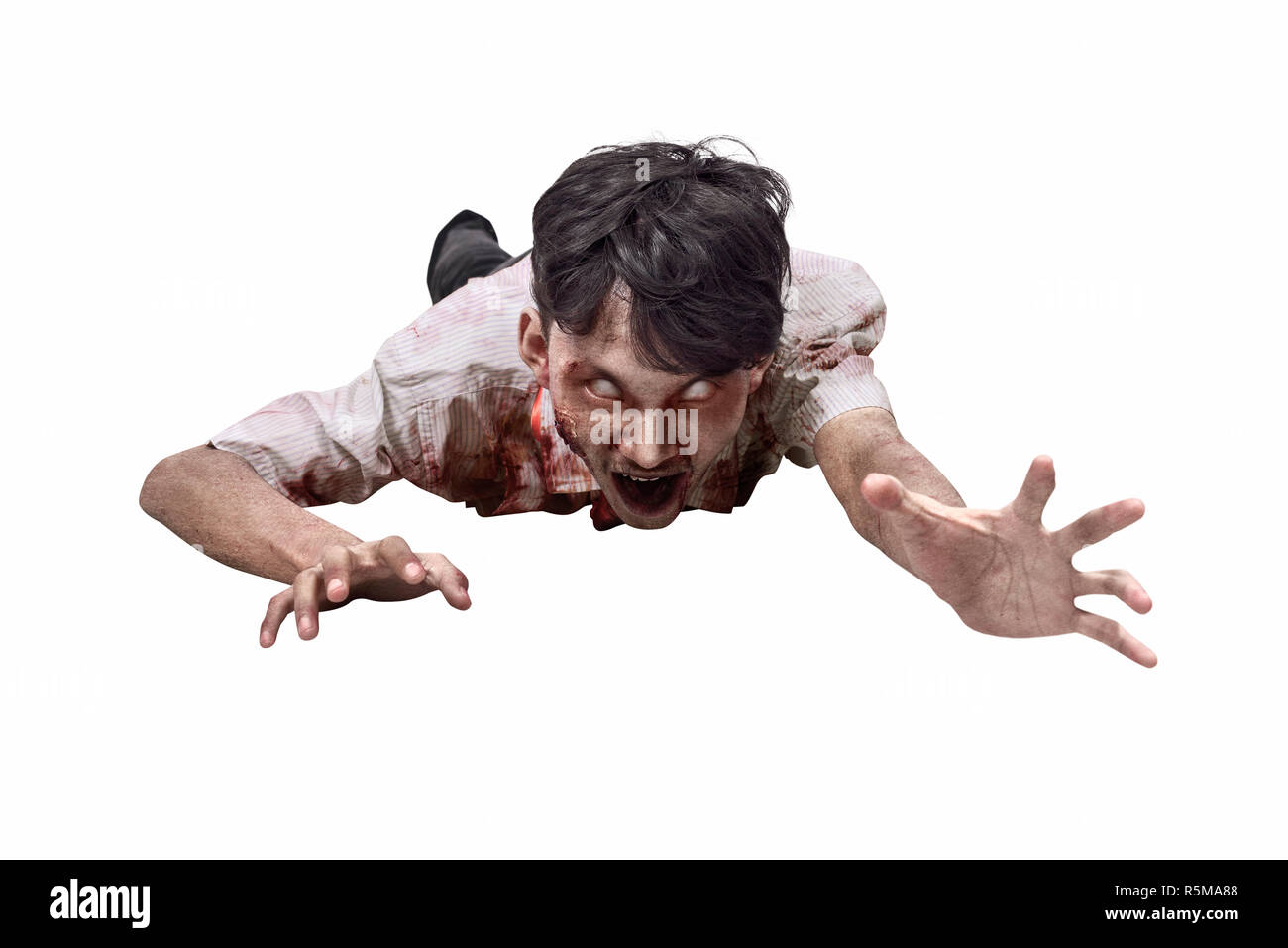 Portrait of asian zombie man in clothes crawling - Stock Image