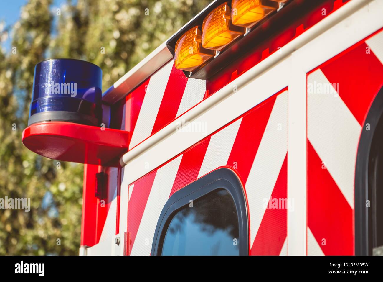 blue flashing light on a red ambulance Stock Photo
