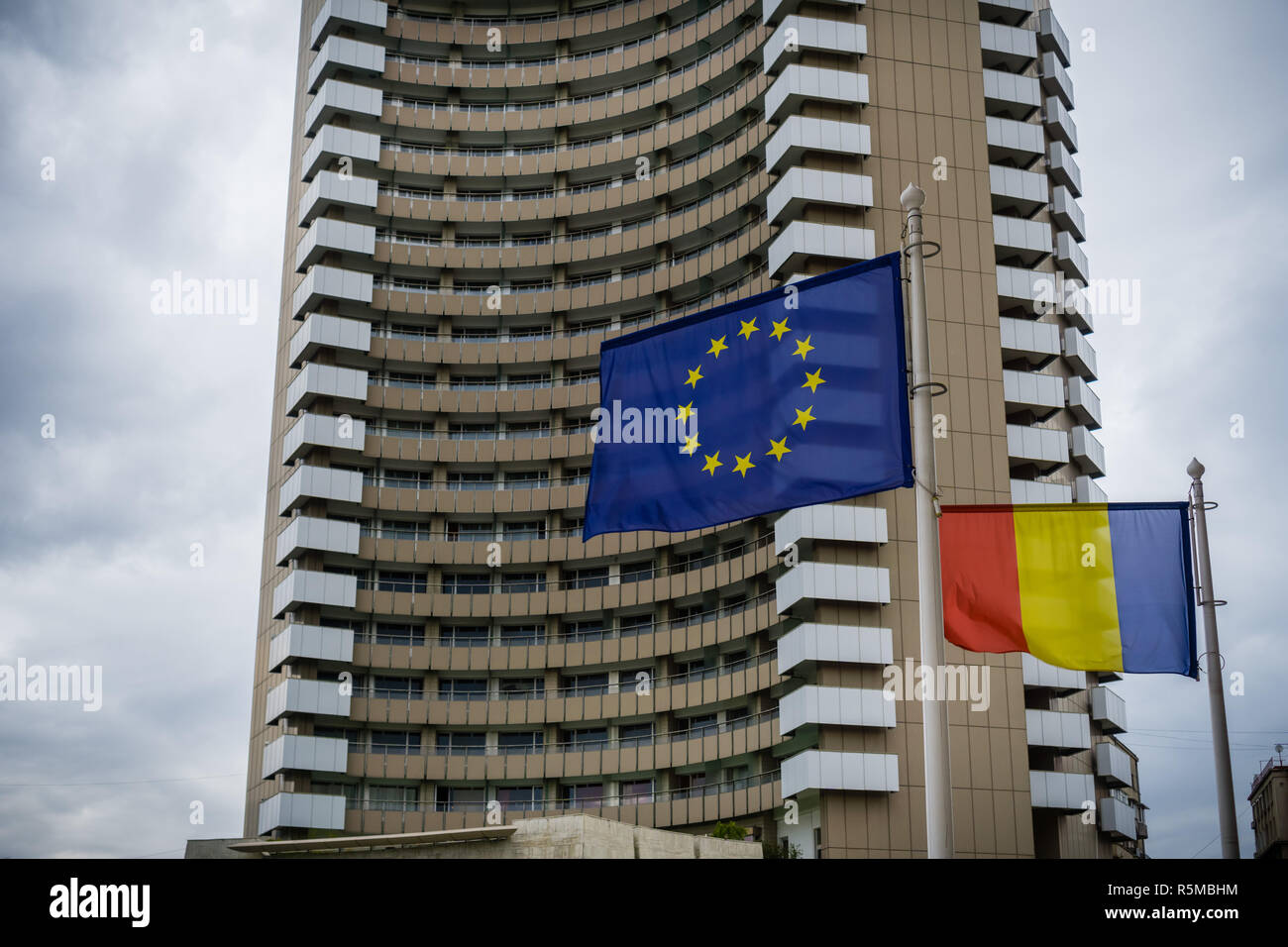 September 22, 2017 Bucharest/Romania - The Romanian and European Union flags raised in front of Intercontinental Hotel in Univestitatii Square - Stock Image