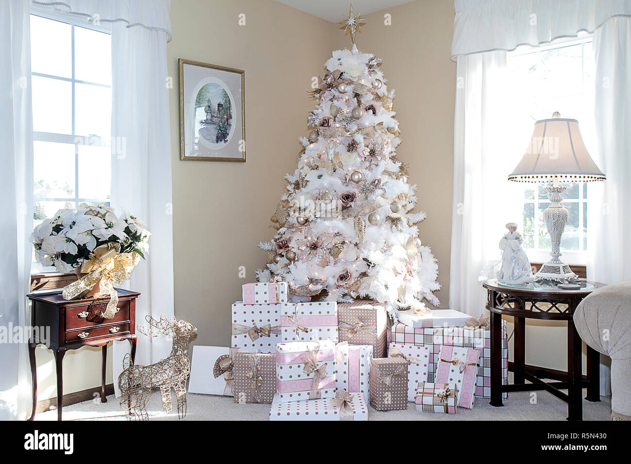 White Dreamy Christmas Tree In Living Room Of Home Decorated In