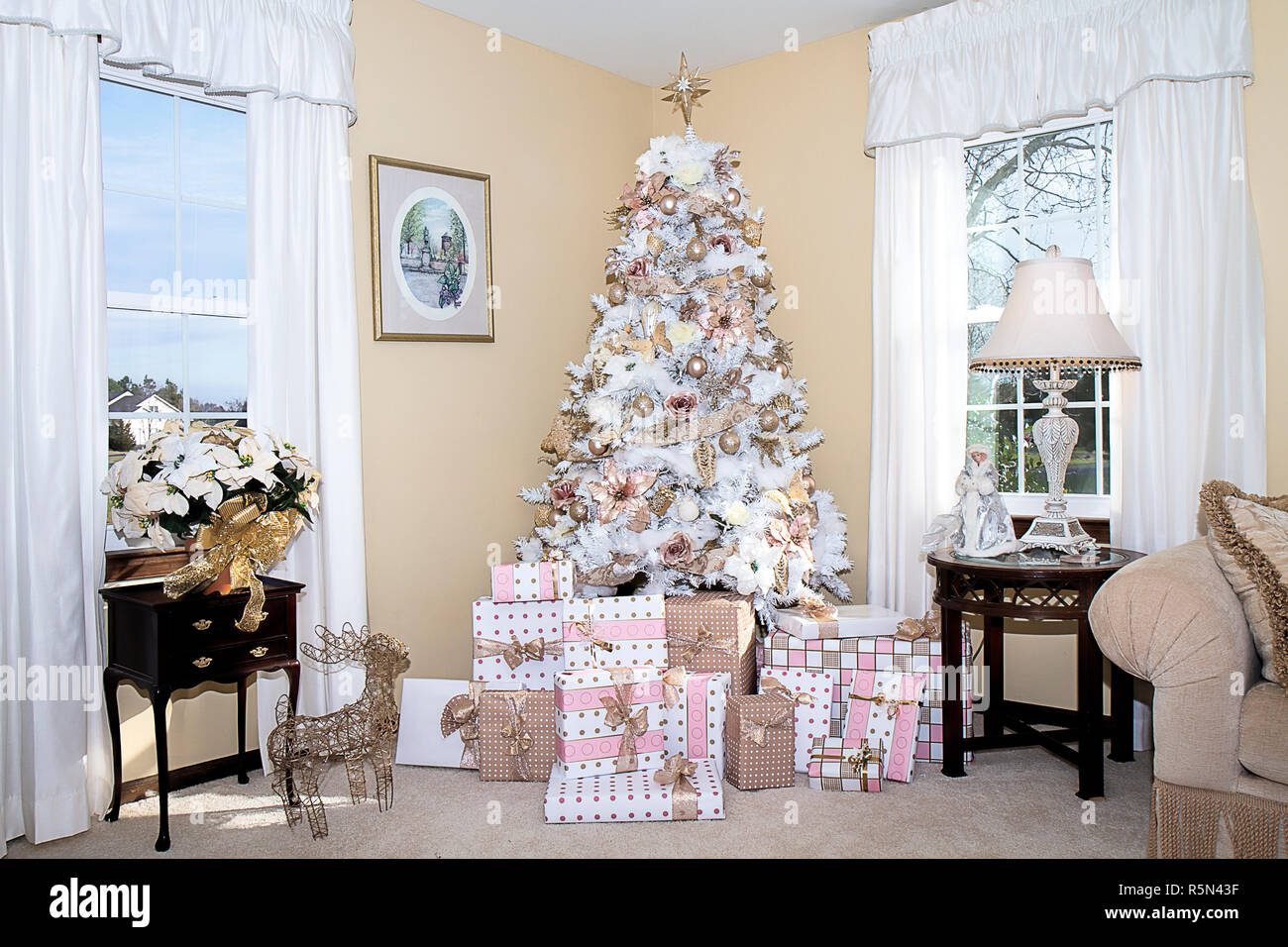 . White dreamy Christmas tree in living room of home decorated in