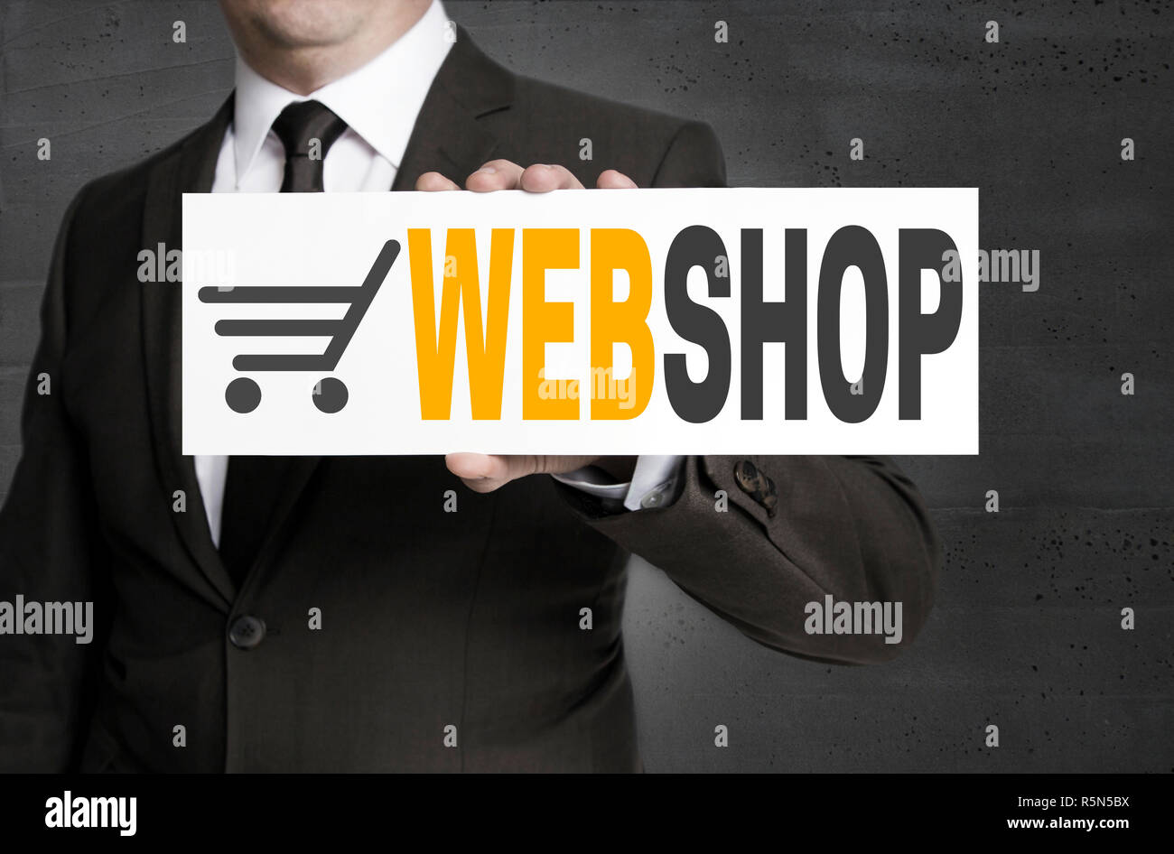 webshop sign is held by businessman Stock Photo