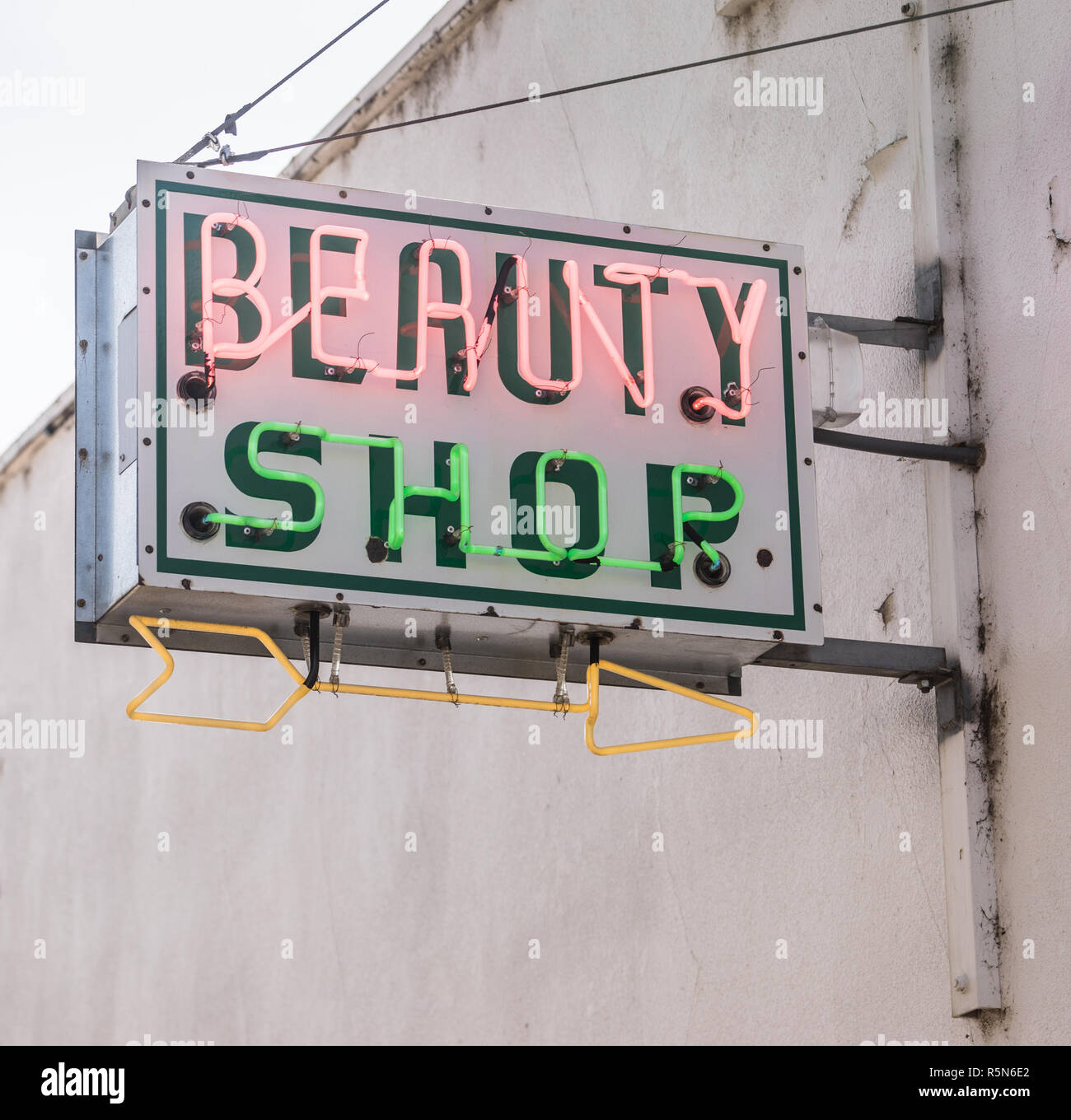Old Small Town Neaon Beauty Shop Sign Vintage Signage - Stock Image