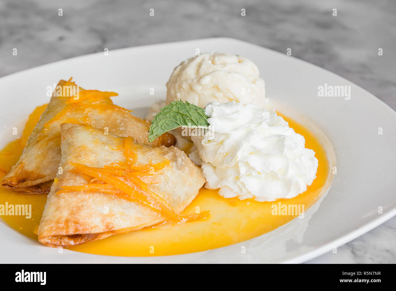 Crepes Suzette French Thin Pancake With Orange Sauce And Ice Cream Stock Photo Alamy