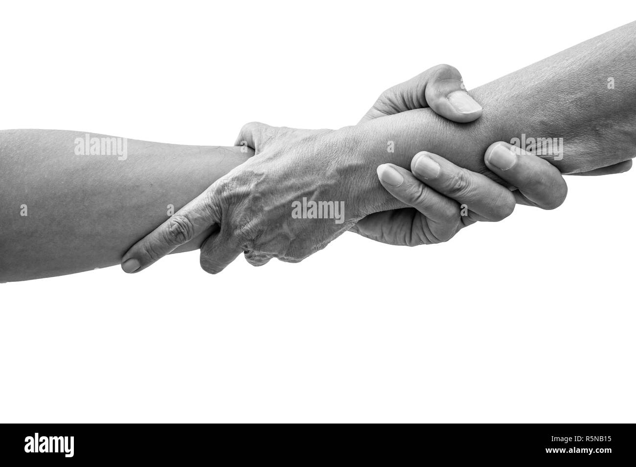 Dramatic black and white help hands holding together representing friendship, partnership, help and hope, donation, assistance. - Stock Image