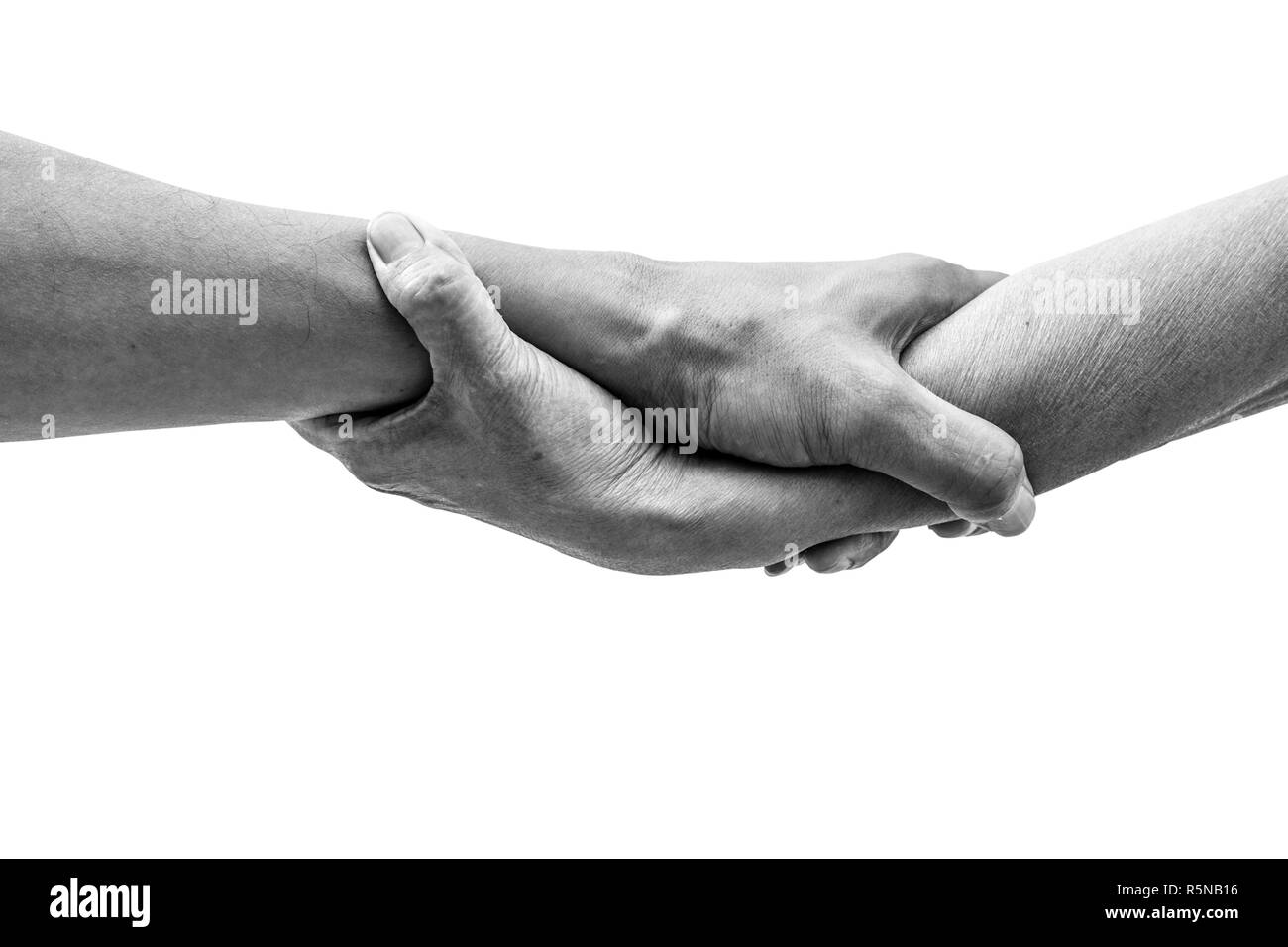 Dramatic black and white help hands holding together representing friendship partnership help and hope donation assistance