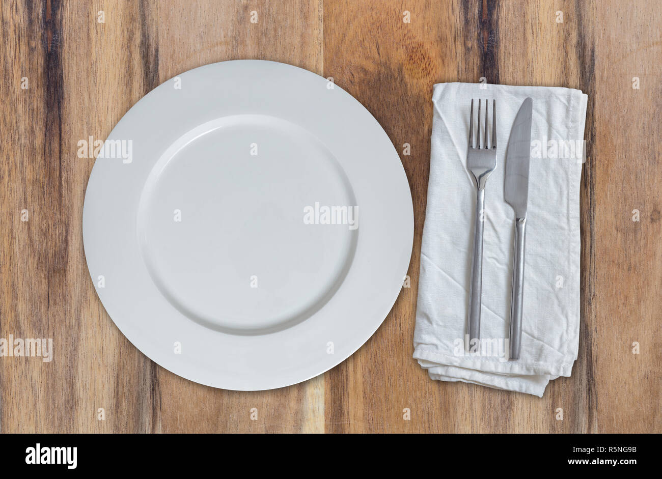 empty dish with cutlery on acacia wood. aerial view Stock Photo