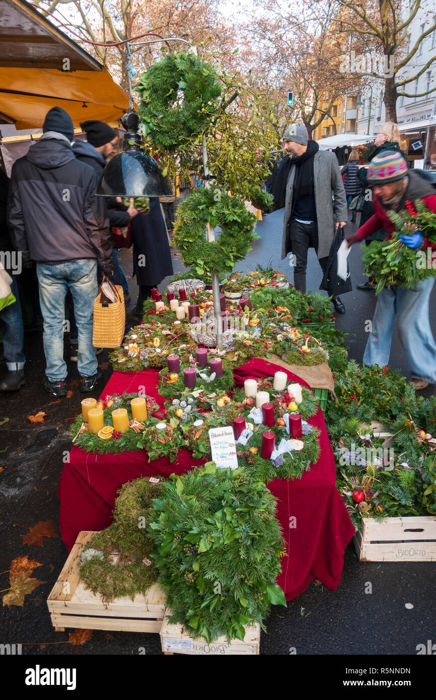 Christmas decorations and wreaths for sale at weekend market in Kollwitzplatz Prenzlauer Berg , Berlin, Germany - Stock Image