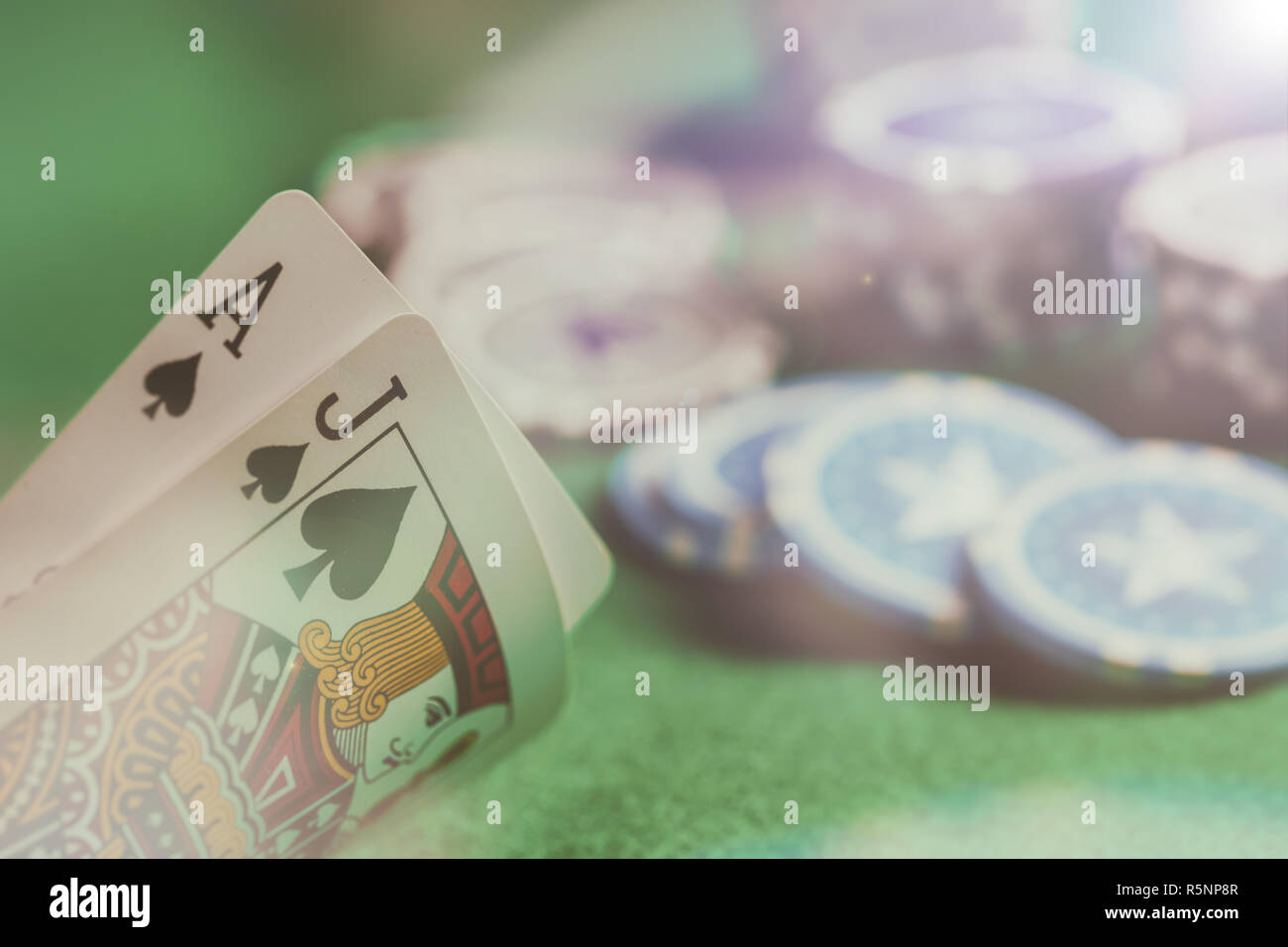 Casino, gambling concept. Blackjack and poker chips on green felt abstract background - Stock Image