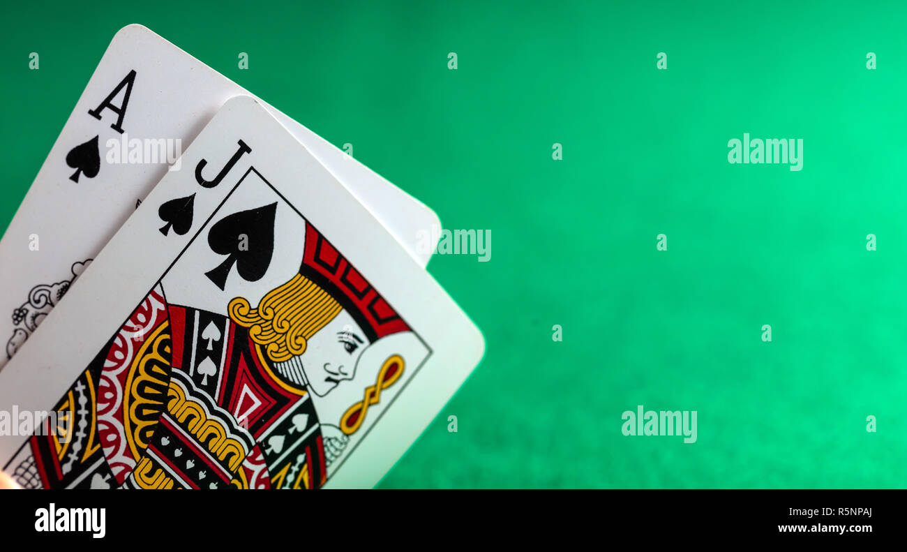 Casino, poker, gambling concept. Blackjack on green felt background, copy space - Stock Image