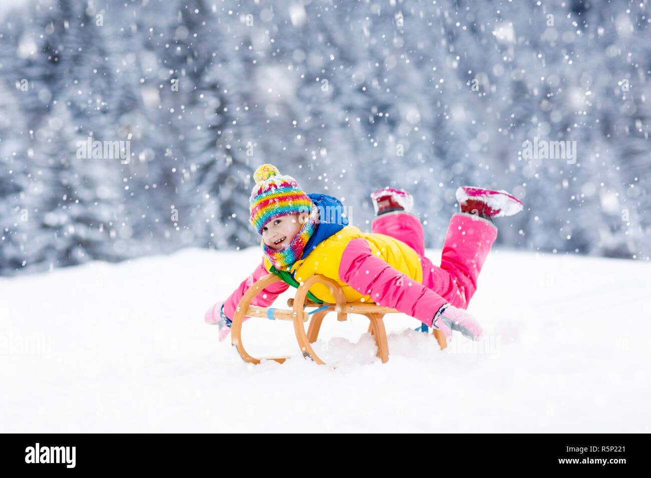 dc0aae3f0 Little girl enjoying a sleigh ride. Child sledding. Toddler kid ...