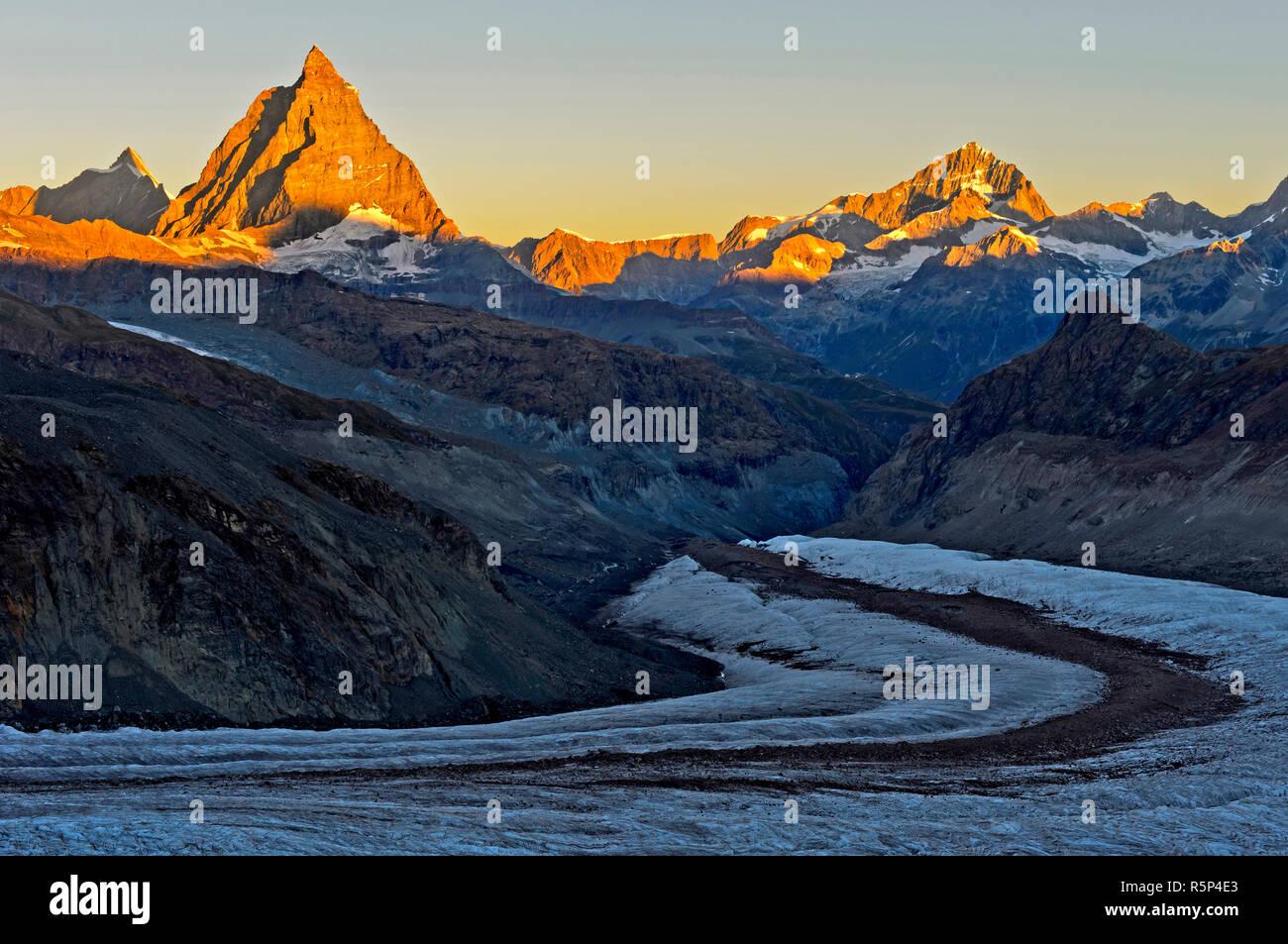 Morning sun at the Matterhorn, Dent d'Herens left, Dent Blanche right, Gorner glacier in front, Zermatt, Valais, Switzerland Stock Photo