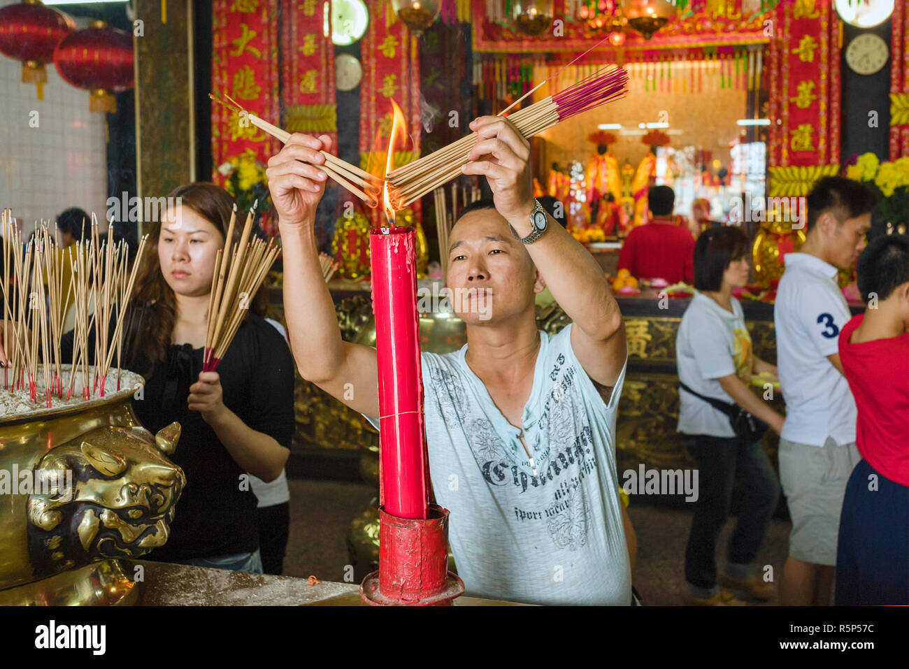 offerings incense sticks and pray inside of the Goddess of