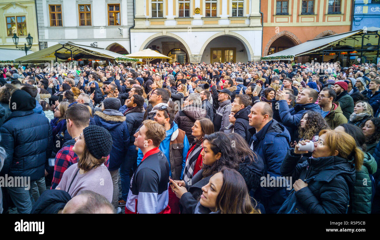 PRAGUE, CZECH REPUBLIC - DECEMBER 31, 2017 - Big crowd looking at the clock tower in Prague, Czechia. People taking pictures and videos when the clock Stock Photo