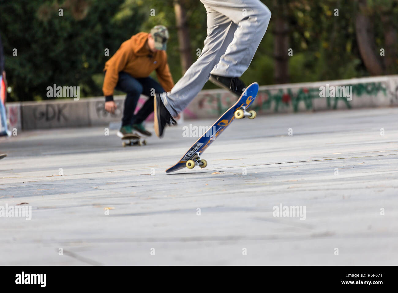 PRAGUE, CZECH REPUBLIC - OCTOBER 12, 2017 - Low angle view of young people doing skateboard tricks in Letna Park in Prague, Czech Republic. Stock Photo