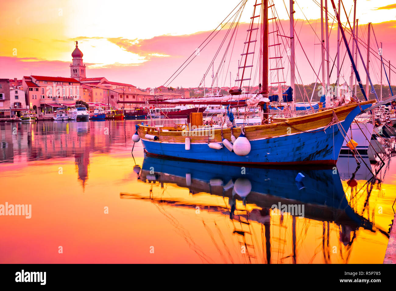 Historic island town of Krk golden dawn waterfront view Stock Photo